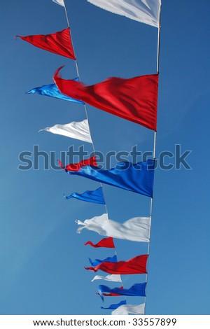 Small triangular waving flags.