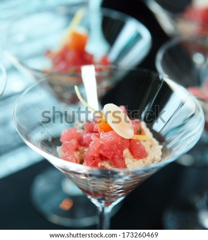 Small tuna snack in a cocktail glass
