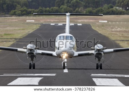 Small twin engined aircraft on a runway