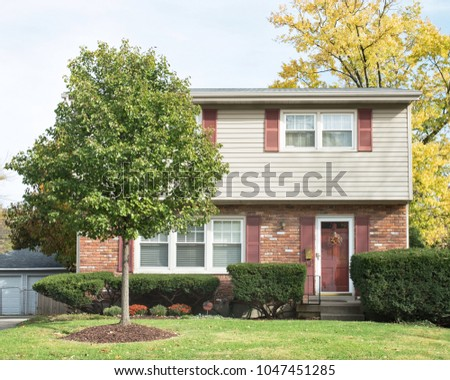 Small Two Story House with Front Crabapple Tree
