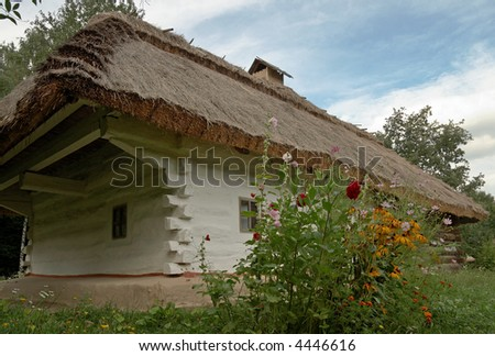 Small Ukrainian historical house (preceding century, museum of Ukrainian folk architecture in Pirogovo villlage (near Kiev)) - stock photo