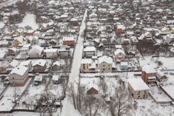 Small village in winter. Outskirts of a big cityView from above.