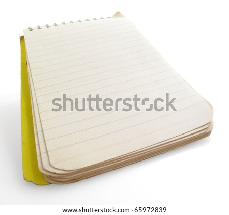 Small vintage spiral note pad on a white background