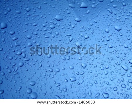 Small water drops on blue surface after rain