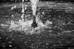 Small water fountain gushing upwards
