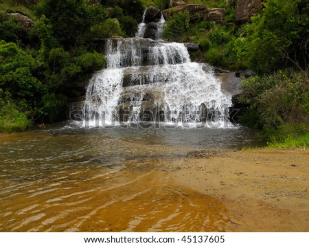 Small waterfall and pool in a tranquil mountain stream