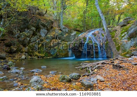 Stock Photo small waterfall in a mountain canyon