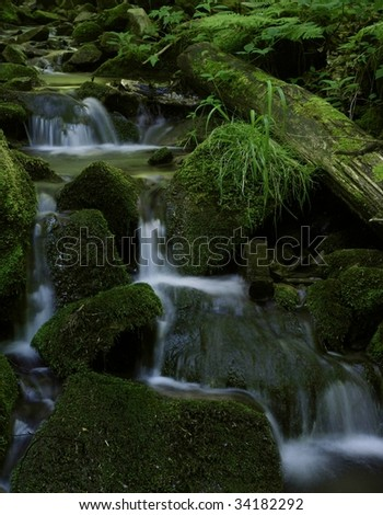 small waterfall in mountain (Beskidy, Silesia, Poland)