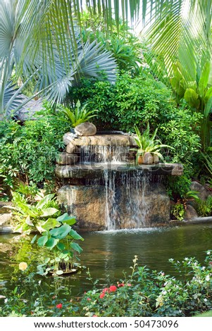 small waterfall in tropical garden