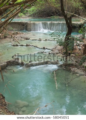 Small waterfall with emerald color water on the way of Wang Kan Lueang Waterfall , Tha Luang, Lop Buri, Thailand