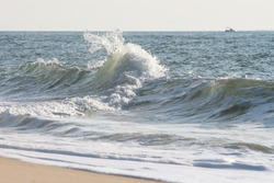 small wave in edge of beach has pyla