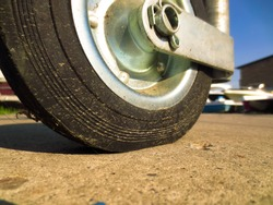 Small wheel with a rubber tire. The front wheel of the trailer for transporting the boat