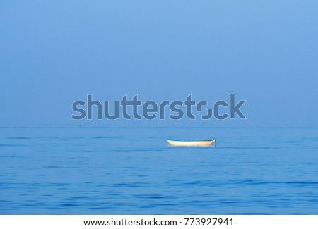 small white boat sailing alone in the  blue sea. and  beautiful blue sky #773927941