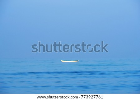 small white boat sailing alone in the  blue sea. and  beautiful blue sky For use as background #773927761