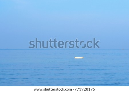 small white boat sailing alone in the  blue sea. and  beautiful blue sky For use as background #773928175