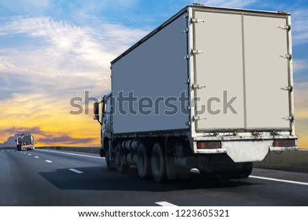 Small White Truck on highway road with  container, transportation concept.,import,export logistic industrial Transporting Land transport on the asphalt expressway Against Sky During Sunset #1223605321