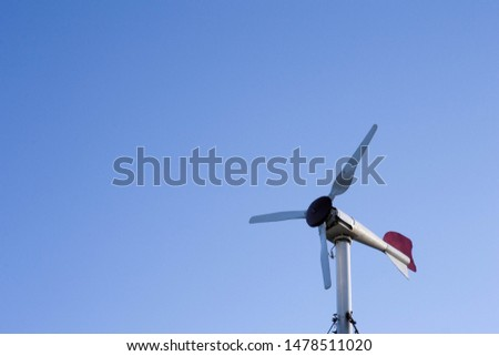 Small wind turbine is producing electricity for houses and agricultural areas, country areas, green and renewable sustainable energy for small houses