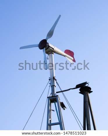 Small wind turbine to produce electricity for houses and agricultural areas, country areas, green and renewable sustainable energy for small houses