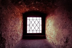 Small window inside thick mediaval castle wall