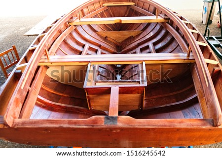Small wooden boat construction details - cockpit details view from stern.