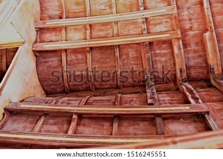 Small wooden boat construction details - stringers, frames and planking.