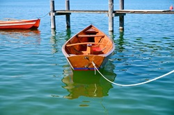 Small wooden boat on pier. Chiemsee lake.