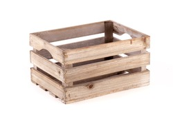Small wooden box crate used for fruit or vegetables on a farm or shop. Slatted pine crate isolated on a white background