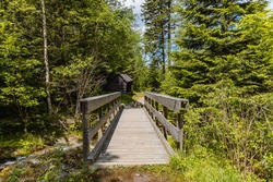 Small wooden bridge next to wooden bower on mountain trail in Giant Mountains