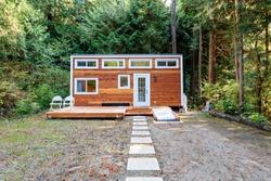 Small wooden cabin house. Exterior design.