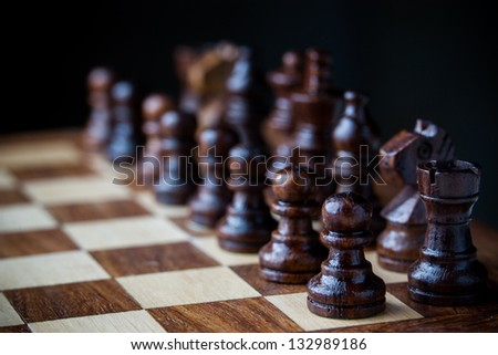 Small wooden chess pieces