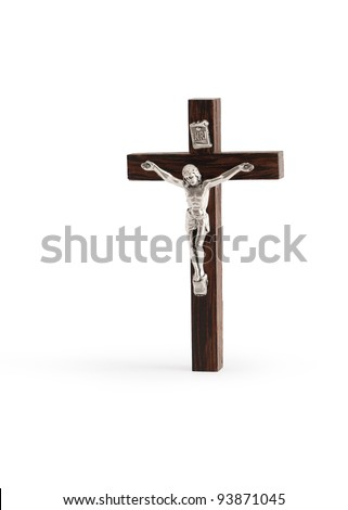 Small wooden crucifix standing on white background. Isolated with clipping path