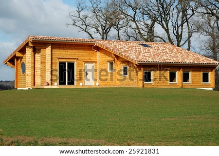 small wooden house in the countryside in french