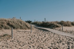 small wooden path leading to a beach