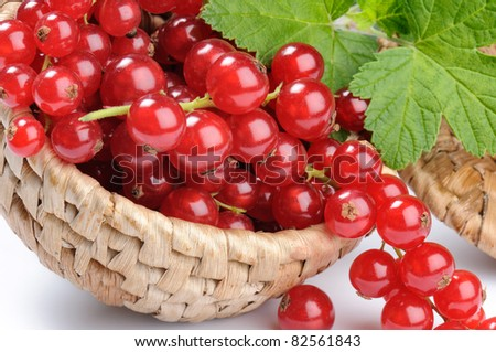 Small woven basket full of red currant
