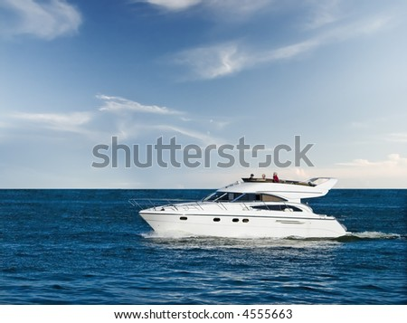Small yacht cruising in blue sea - stock photo