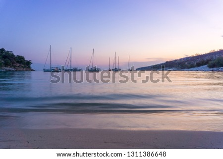 Small yachts anchored in quiet water before the dawn. Dawn in the harbor with yachts #1311386648