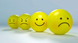 Small yellow balls showing different types of emotions