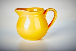 Small Yellow Ceramic Pitcher Jug on isolated white background