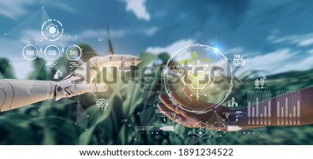 smart agriculture futuristic industry 4.0 technology concept, cyborg hand put to touch hand with green leaves with hud technology including artificial intelligence, 5g to analysis data of smart farm