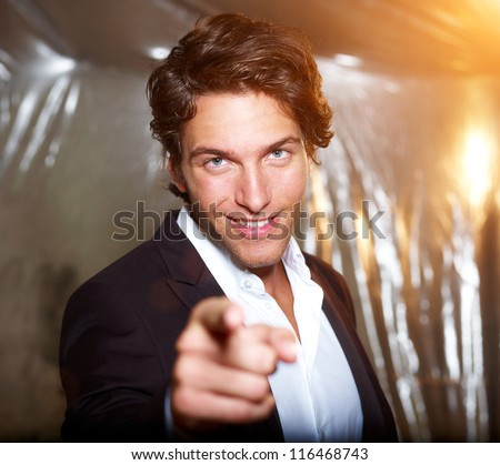 smart attractive businessman points his finger on you