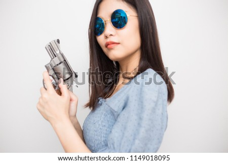 7466c5bf2 Smart beautiful women pointing revolver gun into camera on white background  #1149018095