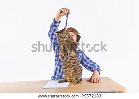 smart boy learning for school has a break and plays with his cat