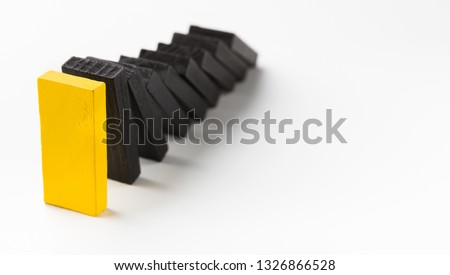 Smart business management. Domino effect stopped by unique strong piece, white panorama background with free space