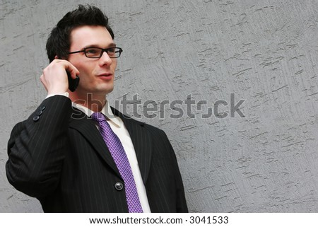 Smart businessman makes a phone call
