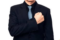 Smart businessman showing a trust by put his fist on a left chest.