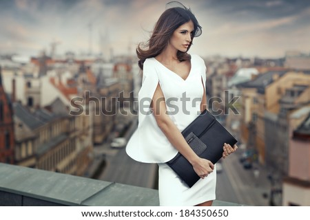 Smart businesswoman on the roof of the building