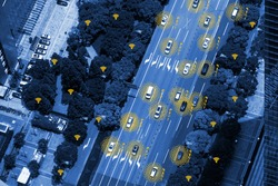 Smart car (HUD) , iot , Autonomous self-driving mode vehicle on metro city road iot concept with graphic sensor radar signal system and internet sensor connect. Blue tone image. Bird eye view.