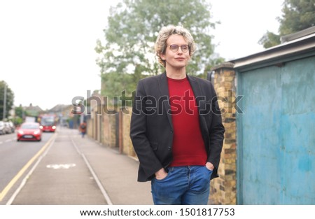 Smart casual looking guy walking down the street #1501817753