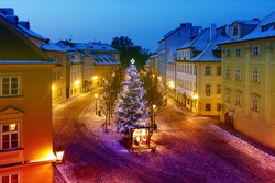Smart christmas tree at the street in Prague. Early morning time.