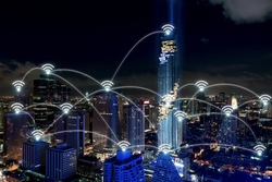 Smart city and wireless communication network, business district with office building, abstract image visual, internet of things concept.